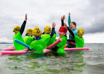 Swim Safe programme taking place on the beach at Shore Road, Poole. The joint programme run by the RNLI and Swim England aims to teach children between the ages of 7 and 14 skills that help them to stay safe in the sea and open water.